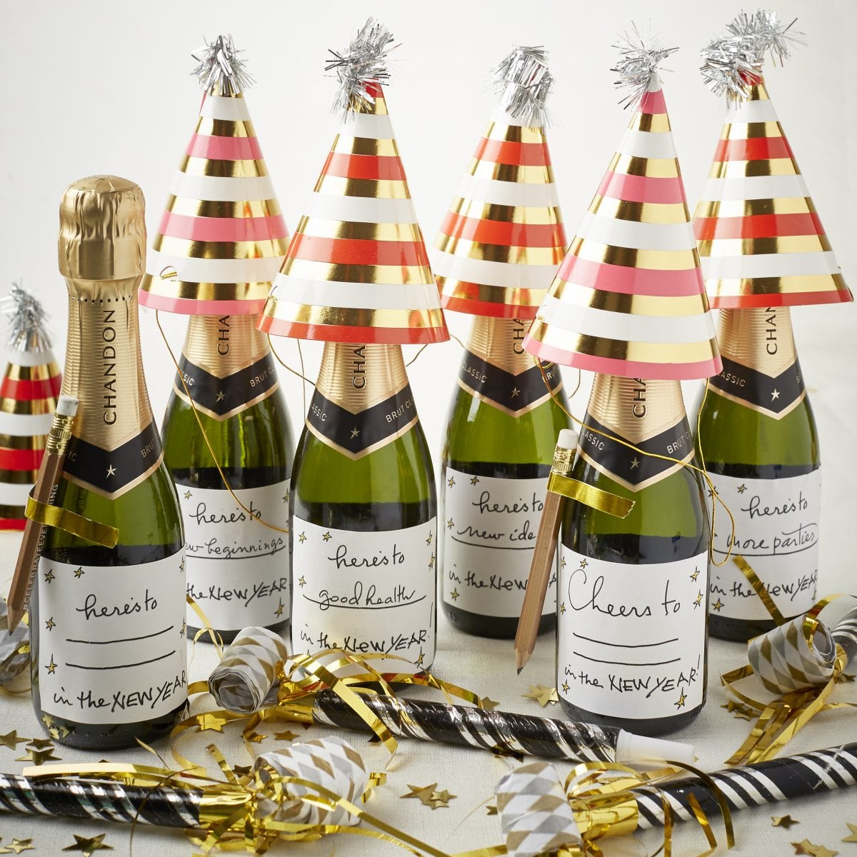 darcy miller designs new years champagne toast resolution favor cheers